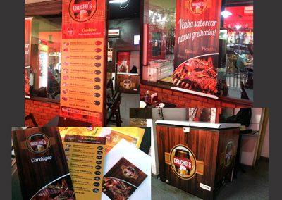 Cliente: Gaúchos restaurante (Envelopamento de freezer, Cardápios em PVC, Panfletos, Banner)
